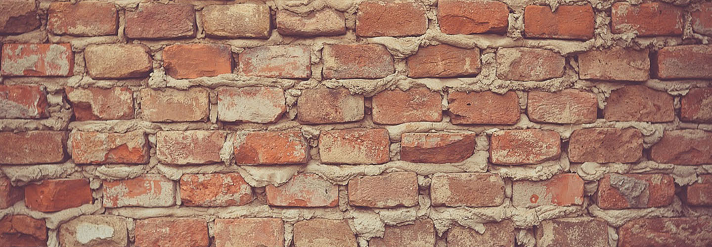 subH_AboutUs_0009_brick-wall.jpg
